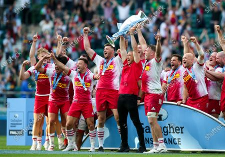 Mike Brown with Alex Dombrandt of Harlequins & Stephan Lewies (Captain) of Harlequins lifts the  Premiership Trophy
