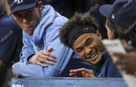 Tampa Bay Rays pitchers Ryan Yarbrough, left, Chris Archer and Tyler Glasnow talk in the dugout during a baseball game against the Los Angeles Angels, in St. Petersburg, Fla