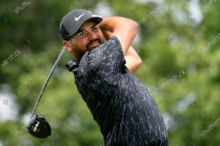 Jason Day watches his shot on the first tee during the third round of the Travelers Championship golf tournament at TPC River Highlands, in Cromwell, Conn