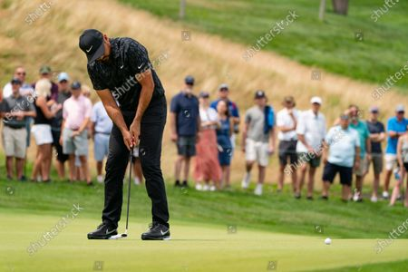 Jason Day birdies on the first green during the third round of the Travelers Championship golf tournament at TPC River Highlands, in Cromwell, Conn