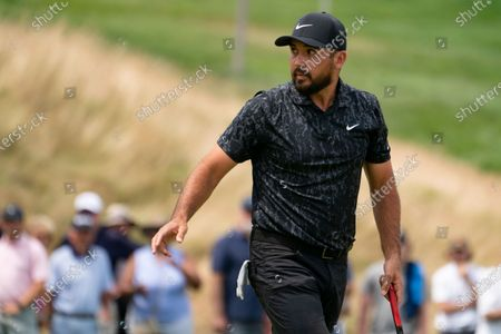 Jason Day acknowledges the crowd after sinking a birdie on the first green during the third round of the Travelers Championship golf tournament at TPC River Highlands, in Cromwell, Conn
