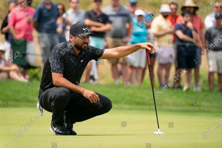 Jason Day lines up his shot on the first green during the third round of the Travelers Championship golf tournament at TPC River Highlands, in Cromwell, Conn