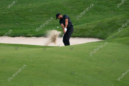 Jason Day hits from a bunker on the 18th fairway during the third round of the Travelers Championship golf tournament at TPC River Highlands, in Cromwell, Conn