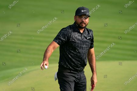 Jason Day reacts after sinking a birdie put on the 15th green during the third round of the Travelers Championship golf tournament at TPC River Highlands, in Cromwell, Conn