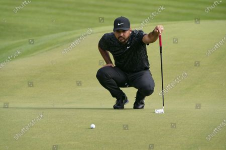 Jason Day lines up a shot on the 15th green during the third round of the Travelers Championship golf tournament at TPC River Highlands, in Cromwell, Conn