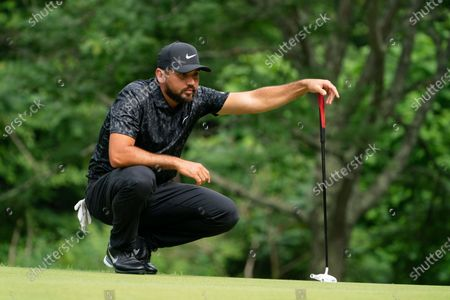 Jason Day lines up a shot on the 14th green during the third round of the Travelers Championship golf tournament at TPC River Highlands, in Cromwell, Conn