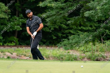 Jason Day hits from the rough onto the 14th green during the third round of the Travelers Championship golf tournament at TPC River Highlands, in Cromwell, Conn