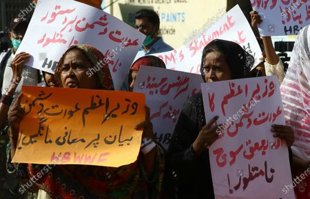 Pakistani women hold placards reading in Urdu 'PM apologize over anti-women statement' during a protest against the statement of the Prime Minister Imran Khan on women's clothing, in Karachi, Pakistan, 26 June 2021. In an interview on HBO, the Prime Minister had dubbed women's clothing as a cause of rape in Pakistan.