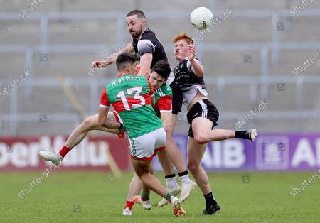 Stock Image of Sligo vs Mayo. Mayo's Tommy Conroy and Conor Loftus with Paul Kilcoyne and Evan Lyons of Sligo
