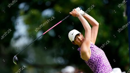Michelle Wie West hits from the tee on the tenth hole during the third round of play in the KPMG Women's PGA Championship golf tournament, in Johns Creek, Ga