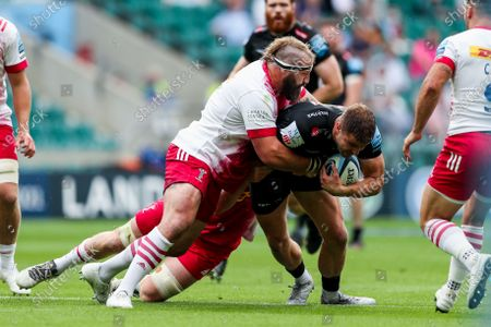 Ollie Devoto of Exeter Chiefs is tackled by Joe Marler of Harlequins