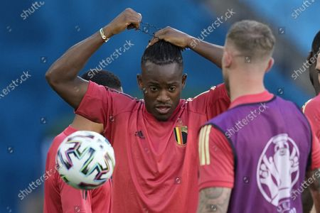 Belgium's Michy Batshuayi adjust his hair during a training session at the La Cartuja stadium in Seville, Spain, . Belgium will play against Portugal on Sunday for the round of 16 of the Euro 2020 soccer championship