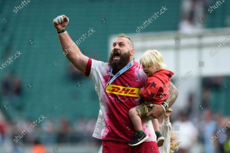 Joe Marler of Harlequins celebrates with his child after the match
