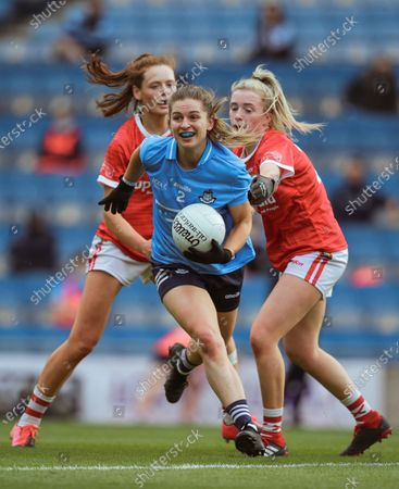 Stock Image of Cork vs Dublin. Dublin's Martha Byrne with Méabh Cahalane and Daire Kiely of Cork