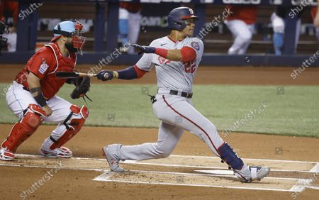 Washington Nationals' Juan Soto (22) doubles against Miami Marlins starting pitcher Zach Thompson during the first inning of a baseball game, in Miami