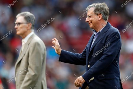 Boston Red Sox chairman Tom Werner, right, and owner John Henry, left, walk on the filed before a baseball game against the New York Yankees, in Boston