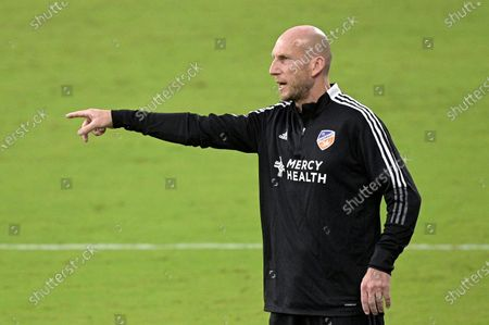 Stock Image of Cincinnati head coach Jaap Stam calls instructions during the first half of an MLS soccer match against Toronto FC, in Orlando, Fla