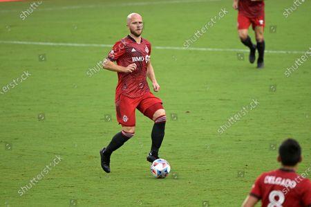 Toronto FC midfielder Michael Bradley controls a ball during the first half of an MLS soccer match against FC Cincinnati, in Orlando, Fla