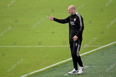 Cincinnati head coach Jaap Stam calls out instructions during the first half of an MLS soccer match against Toronto FC, in Orlando, Fla