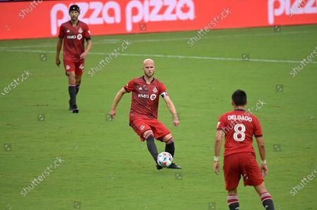 Toronto FC midfielder Michael Bradley (4) controls a ball during the first half of an MLS soccer match against FC Cincinnati, in Orlando, Fla