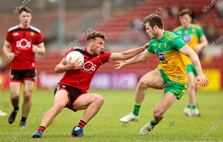 Down vs Donegal. Barry O'Hagan of Down with Eoghan Ban Gallagher of Donegal
