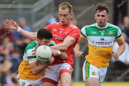 Stock Picture of Offaly vs Louth. Offaly's Ruairi McNamee and Jordan Hayes with Ciaran Byrne of Louth