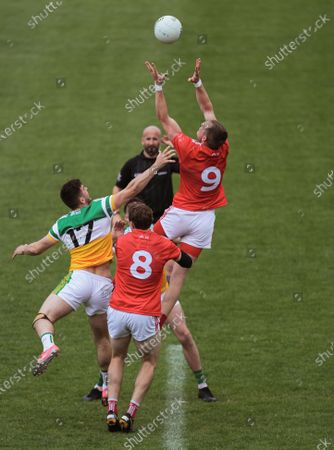 Stock Image of Offaly vs Louth. Offaly's Eoin Carroll and Jordan Hayes contest the throw in with Bevan Duffy and Ciaran Byrne of Louth