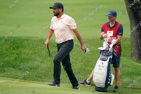 Jason Day, of Australia, walks up to the second green during the final round of the Travelers Championship golf tournament at TPC River Highlands, in Cromwell, Conn