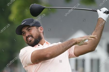 Jason Day, of Australia, watches his shot on the third tee during the final round of the Travelers Championship golf tournament at TPC River Highlands, in Cromwell, Conn