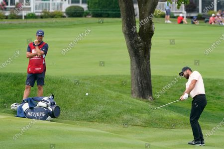 Jason Day, of Australia, chips up to the second green during the final round of the Travelers Championship golf tournament at TPC River Highlands, in Cromwell, Conn
