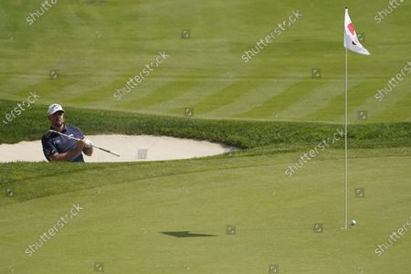 Stock Picture of Marc Leishman, of Australia, reacts top a bunker shot on the 18th hole during the final round of the Travelers Championship golf tournament at TPC River Highlands, in Cromwell, Conn