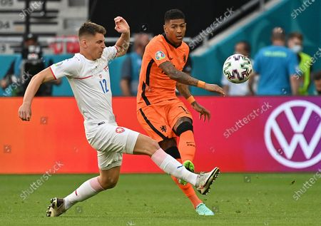 Stock Image of Patrick van Aanholt (R) of the Netherlands in action against Lukas Masopust of the Czech Republic during the UEFA EURO 2020 round of 16 soccer match between the Netherlands and the Czech Republic in Budapest, Hungary, 27 June 2021.