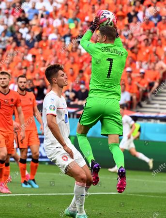Goalkeeper Maarten Stekelenburg of the Netherlands (R) catches the ball in front of Patrik Schick of the Czech Republic during the UEFA EURO 2020 round of 16 soccer match between the Netherlands and the Czech Republic in Budapest, Hungary, 27 June 2021.