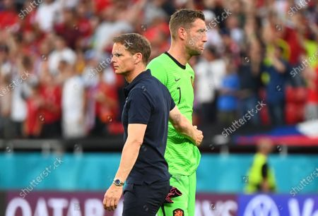 Stock Image of Netherlands's head coach Frank de Boer (L) reacts with goalkeeper Maarten Stekelenburg  after losing the UEFA EURO 2020 round of 16 soccer match between the Netherlands and the Czech Republic in Budapest, Hungary, 27 June 2021.