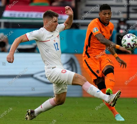 Czech Republic's Lukas Masopust, left, challenges Patrick van Aanholt of the Netherlands during the Euro 2020 soccer championship round of 16 match between Netherlands and Czech Republic at the Ferenc Puskas stadium in Budapest, Hungary