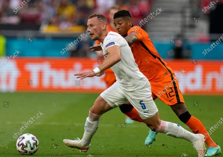 Stock Photo of Patrick van Aanholt of the Netherlands, right, challenges Czech Republic's Vladimir Coufal during the Euro 2020 soccer championship round of 16 match between Netherlands and Czech Republic at the Ferenc Puskas stadium in Budapest, Hungary