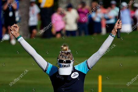 Nelly Korda of the U.S. looks toward the ground with her sunglasses on her head, as she celebrates winning the KPMG Women's PGA Championship golf tournament, in Johns Creek, Ga