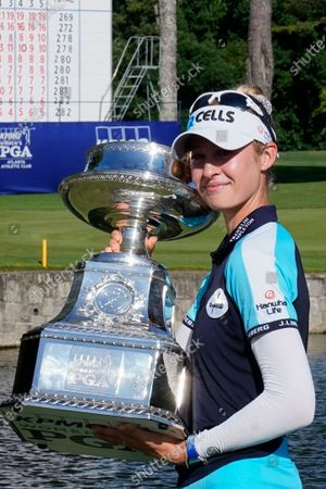 Nelly Korda of the U.S. holds the trophy after winning the KPMG Women's PGA Championship golf tournament, in Johns Creek, Ga