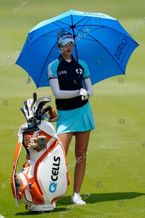 Nelly Korda waits to hit from the 16th fairway during the final round of play in the KPMG Women's PGA Championship golf tournament, in Johns Creek, Ga