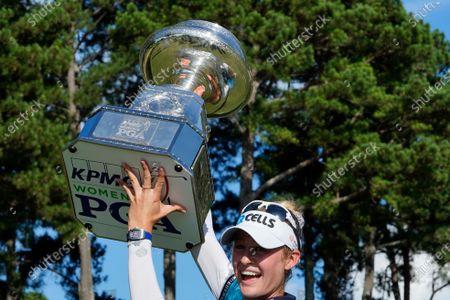 Nelly Korda of the U.S. hoists the trophy after winning the KPMG Women's PGA Championship golf tournament, in Johns Creek, Ga