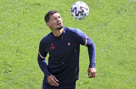 Croatia's Dejan Lovren exercises during a team training session at Parken stadium in Copenhagen, Denmark, the day before the Euro 2020 soccer championship round of 16 match between Croatia and Spain