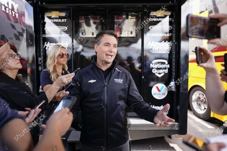 Stock Image of Former Nascar driver Jeff Gordon speaks at a news conference outside a Hendrick Motorsports trailer before the scheduled races at Pocono Raceway, in Long Pond, Pa. It was announced Wednesday that Gordon was leaving the Fox Sports broadcast booth to become vice chairman at Hendrick Motorsport