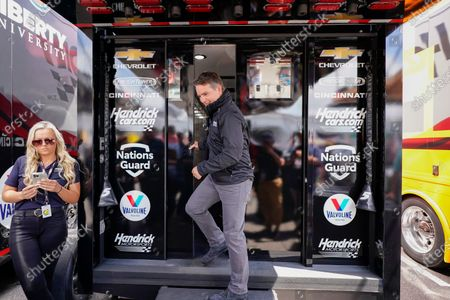 Stock Picture of Former Nascar driver Jeff Gordon exits a Hendrick Motorsports trailer to speak at a news conference before the scheduled races at Pocono Raceway, in Long Pond, Pa. It was announced Wednesday that Gordon was leaving the Fox Sports broadcast booth to become vice chairman at Hendrick Motorsports