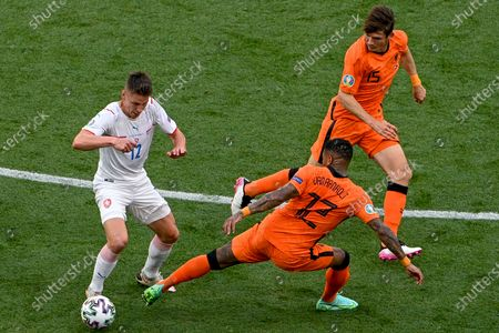 Lukas Masopust (L) of the Czech Republic fights with Patrick van Aanholt (C) and Marten de Roon of the Netherlands for the ball during the UEFA EURO 2020 round of 16 soccer match between the Netherlands and the Czech Republic in Budapest, Hungary, 27 June 2021.