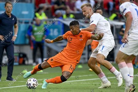 Stock Picture of Patrick van Aanholt (L) of the Netherlands is challenged by Antonin Barak of the Czech Republic for the ball during the UEFA EURO 2020 round of 16 soccer match between the Netherlands and the Czech Republic in Budapest, Hungary, 27 June 2021.