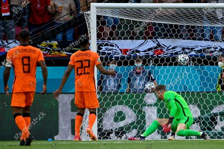 Stock Picture of Denzel Dumfries (C) and goalkeeper Maarten Stekelenburg of Netherlands react after conceding the 0-2 goal during the UEFA EURO 2020 round of 16 soccer match between the Netherlands and the Czech Republic in Budapest, Hungary, 27 June 2021.