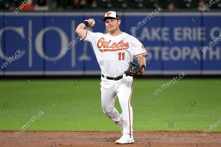 Baltimore Orioles' Pat Valaika fields against the Houston Astros during a baseball game, in Baltimore