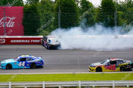 Stock Photo of Josh Williams (92) hits the wall after spinning out going through turn one as Tommy Joe Martins (44) and Jade Buford (48) pass by during a NASCAR Xfinity Series auto race at Pocono Raceway, in Long Pond, Pa