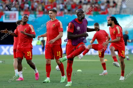 Belgium's Michy Batshuayi, Leander Dendoncker, Romelu Lukaku, Leandro Trossard and Jason Denayer, from left to right, exercise during warmup before the Euro 2020 soccer championship round of 16 match between Belgium and Portugal at La Cartuja stadium in Seville, Spain