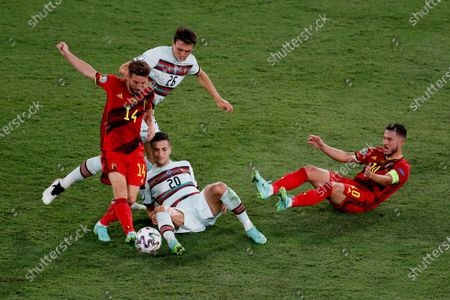 Belgium's Dries Mertens, left, competes for the ball with Portugal's Joao Cancelo, 20, and Portugal's Joao Palhinha, 26, watched by Belgium's Eden Hazard, right, during the Euro 2020 soccer championship round of 16 match between Belgium and Portugal at La Cartuja stadium in Seville, Spain